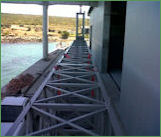 Design and engineering of 10-ton gantry crane door for coastal boat house. Marine specification